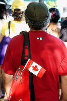 VANCOUVER, CANADA, 1st July 2013. Man with a Canadian flag attached to his backpack at Canada Day celebrations on Granville Island in Vancouver, BC. Canada Day or Fete du Canada is an annual national holiday celebrating Canada's birth as a nation  in 1867.