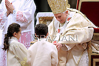 Pope Benedict XVI meets children during the midndight Christmas Mass in Saint Peter's Basilica at the Vatican late 24 December 2010.