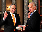 United States Senator Chuck Schumer (Democrat of New York) raises his right hand during the photo-op of the reenactment of his swearing-in in the Old Senate Chamber in the U.S. Capitol in Washington, D.C. on Wednesday, January 5, 2011.  His wife, Iris Weinsall is at center and U.S. Vice President Joe Biden is at right..Credit: Ron Sachs / CNP.(RESTRICTION: NO New York or New Jersey Newspapers or newspapers within a 75 mile radius of New York City)