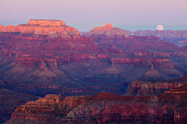 Full moon rising over the Grand Canyon as viewed from Hopi Point on the South Rim. Grand Canyon National Park, Arizona.
