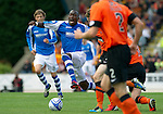 St Johnstone v Dundee United....01.09.12      SPL  .Gregory Tade is brough down by Brian McLean.Picture by Graeme Hart..Copyright Perthshire Picture Agency.Tel: 01738 623350  Mobile: 07990 594431