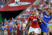 Gabriel Obertan, Chance Myers (blue)...Kansas City Wizards defeated Manchester United 2-1 in an international friendly at Arrowhead Stadium, Kansas City, Missouri.