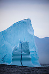 Limited edition C-Type Prints available - contact me for more details.<br /> <br /> An iceberg with a vertical line of dense blue ice running through from top to bottom, at the mouth of Kangderluqussuaq Fjord, East Greenland, 2009