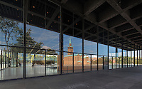 The Neue Nationalgalerie or New National Gallery, a modern art museum at the Kulturforum in West Berlin, Germany. The building and its sculpture gardens were designed by Ludwig Mies van der Rohe, 1886-1969, and opened in 1968. The St Matthaus-Kirche is reflected in its glass windows. Picture by Manuel Cohen