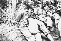 The March of Death.  Along the March (on which) these prisoners were photographed, they have their hands tied behind their backs.  The March of Death was about May 1942, from Bataan to Cabanatuan, the prison camp.  (Marine Corps)<br /> Exact Date Shot Unknown<br /> NARA FILE #:  127-N-114541<br /> WAR &amp; CONFLICT BOOK #:  1144