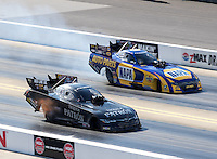 Sep 17, 2016; Concord, NC, USA; NHRA funny car driver Alexis DeJoria (near) races alongside Ron Capps during qualifying for the Carolina Nationals at zMax Dragway. Mandatory Credit: Mark J. Rebilas-USA TODAY Sports
