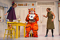 London, UK. 03.07.2014. THE TIGER WHO CAME TO TEA roars into the West End. Adapted from Judith Kerr's book, and directed by, David  Wood, the children's show opens at the Lyric Theatre, Shaftesbury Avenue. Abbey Norman plays the little girl, Sophie,  Jenanne Redman, her mummy, and Matthew Dudley, the tiger, Sophie's daddy, the Milkman and the Postman. Photograph © Jane Hobson.