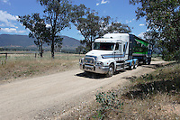 Agricultural feed truck on country road.<br />