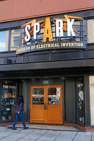 Woman entering the Spark Museum of Electrical Invention in downtown Bellingham, Washington state, USA