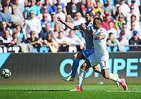 Swansea City's Jordan Ayew vies for possession with Stoke City's Erik Pieters<br /> <br /> Photographer Kevin Barnes/CameraSport<br /> <br /> The Premier League - Swansea City v Stoke City - Saturday 22nd April 2017 - Liberty Stadium - Swansea<br /> <br /> World Copyright &copy; 2017 CameraSport. All rights reserved. 43 Linden Ave. Countesthorpe. Leicester. England. LE8 5PG - Tel: +44 (0) 116 277 4147 - admin@camerasport.com - www.camerasport.com