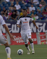 Philadelphia Union defender Carlos Valdes (5) brings the ball forward. In a Major League Soccer (MLS) match, the Philadelphia Union defeated the New England Revolution, 3-0, at Gillette Stadium on July 17, 2011.