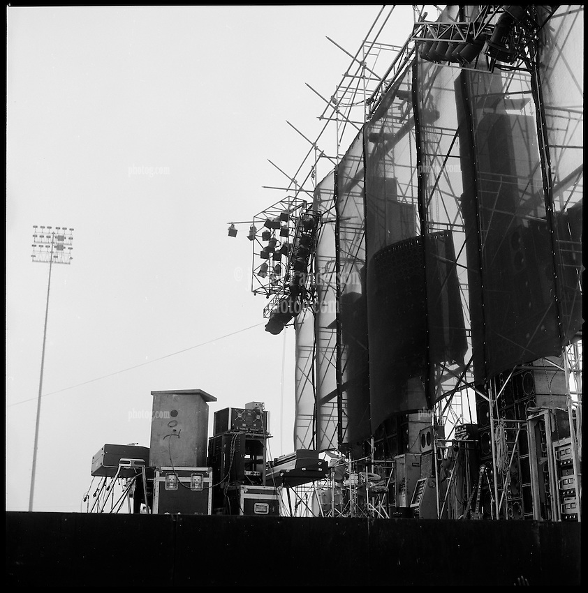 The Grateful Dead Concert at Dillon Stadium on 31 July 1974. B&W Original Film Scan. Photograph taken with a Hasselblad Camera with Tri-X film. View of the Stage, Gear and the Wall of Sound.