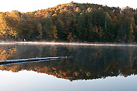 Sunrise and fall color at Ackerman Lake along M-94 near Munising Michigan in the Hiawatha National Forest.