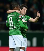 FUSSBALL   1. BUNDESLIGA   SAISON 2013/2014   11. SPIELTAG SV Werder Bremen - Hannover 96                         03.11.2013 Zlatko Junuzovic (li) und Cedrick Makiadi (v.l., beide SV Werder Bremen) jubeln nach dem 2:1