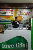 30 year old Haidar Ali is deaf, here he poses for a portrait in Joost, a juice bar in a fitness club in New Delhi, India.