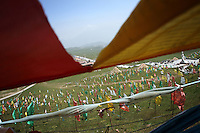 Tibetan payer flags line the hills on the Qinghai-Tibetan Plateau, Qinghai Province. China. 2010