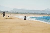Group of motorcycle riders on beach near Todos Santos, Baja, Mexico