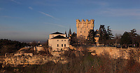 Casa de la Quimica (Chemistry house), 18th century, possibly by Sabatini, left, and Great Tower of John II, Alcazar, 12-16th centuries, right, Segovia, Castile and Leon, Spain. The current Alcazar was begun by King Alfonso VIII (1155-1214) and his wife Eleanor of England (1162-1214), and rebuilt 1258. Juan (John) II (1405-54) added the great Tower. The House of Chemistry, formerly a College of Chemistry now houses the Military Archives. Picture by Manuel Cohen