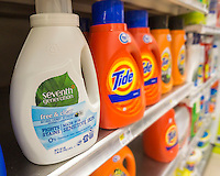 Seventh Generation brand laundry detergent next to market leader Procter and Gamble's Tide on a supermarket shelf in New York on Tuesday, September 20, 2016. Unilever announced that it has agreed to buy Vermont-based Seventh Generation, a plant-based household products manufacturer for about $700 million. Seventh Generation had $200 million in revenue in 2015 and has seen double-digit growth.  (© Richard B. Levine)