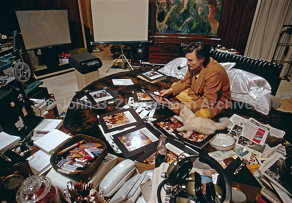 Hugh Hefner working in bed, Chicago, 1973. Color photo by John G. Zimmerman