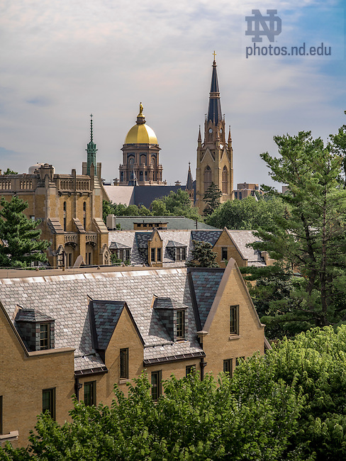 Aug. 6, 2015 Dome and Basilica seen behind Lyons Hall and Morrissey Manor. (Photo by Matt Cashore/University of Notre Dame)