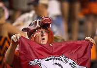 HAWGS ILLUSTRATED JASON IVESTER --08/30/2014--<br /> An Arkansas fan shows his support in the falling rain as play resumes during the fourth quarter on Saturday, Aug. 30, 2014, against Auburn at Jordan-Hare Stadium in Auburn, Ala.