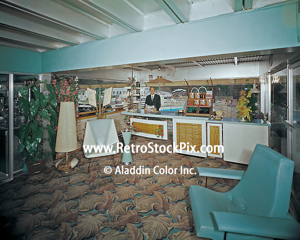 Eden Roc Motel in Wildwood, New Jersey. 1960's photograph of the motel owner behind the front desk in the lobby.