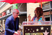 HOLLYWOOD, CA - JULY 15: Pitbull, pictured with Lil Jon, receives star at the Hollywood Walk of Fame in Hollywood, California on July 15, 2016. Credit: David Edwards/MediaPunch