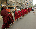 At sunrise shoeless semaneras walk the streets. In Theravada Buddhism, monks go on a daily almsround (Pindacara) to collect food. This is perceived as giving the lay people the opportunity to make merit.
