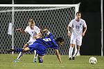 19 September 2014: Duke's Sean Davis (6) is fouled by North Carolina's Verneri Valimaa (18). The Duke University Blue Devils hosted the University of North Carolina Tar Heels at Koskinen Stadium in Durham, North Carolina in a 2014 NCAA Division I Men's Soccer match. Duke won the game 2-1.