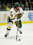 12 December 2009: University of Vermont Catamount defenseman Kevan Miller, a Junior from Los Angeles, CA, in first period action against the St. Lawrence University Saints at Gutterson Fieldhouse in Burlington, Vermont. The Catamounts shut out their former ECAC rival Saints 3-0. Mandatory Credit: Ed Wolfstein Photo