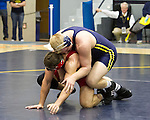 The University of Michigan men's wrestling team,20-19 loss to Nebraska at Cliff Keen Arena in Ann Arbor,Mich., on January 11, 2013....