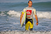 """CJ HOBGOOD (USA)  SEIGNOSSE, France (Sunday, September 27, 2009) - Mick Fanning (AUS), 28, has just claimed his second consecutive ASP Dream Tour event, taking out the 2009 Quiksilver Pro France presented by Orange over fellow Finalist Bede Durbidge (AUS), 26, in punchy one-to-three foot (0.5 - 1 metre) waves at Les Bourdaines...Event No. 7 of 10 on the 2009 ASP World Tour, the Quiksilver Pro France opted to utilize today's swell to complete the event given the dismal surf forecast for the remainder of the waiting period. Despite today's challenging conditions, the world's best surfers executed well, blending their rapid-fire approach with progressive fin-free and aerial surfing...Fanning continued to build momentum through the final day of competition before erupting in the Final with a flurry of excellent scoring rides, a 7.83, an 8.83 and a 7.33 in the opening half of the competition...""""I was really fortunate to get those couple of good ones at the start because I really ran out of gas there at the end,"""" Fanning said. """"It's two back-to-back events where I have had to surf four heats on the final day to get the win and it takes a lot out of you. The conditions were deteriorating and I was fortunate to get those scores on the board early on.""""..Today's victory marks the second in a row for Fanning, having proven victorious in Southern California last week. The win further cements Fanning in second position on the 2009 ASP World Tour ratings, cutting the distance between himself and frontrunner Joel Parkinson (AUS), 28, from 936 points (pre-France) to a scant 146 points heading into Spain..The event had a waiting period from September 23rd to October 4 2009. The Quiksilver Pro France was a mobile event and depending on conditIons can be held at either Hossegor, Seignosse, Capbreton or Saint Jean de Luz and was designed to take advantage of the best waves on any given day the Atlantic Ocean had to offer in the South West region of France. Photo: joliphotos.com"""