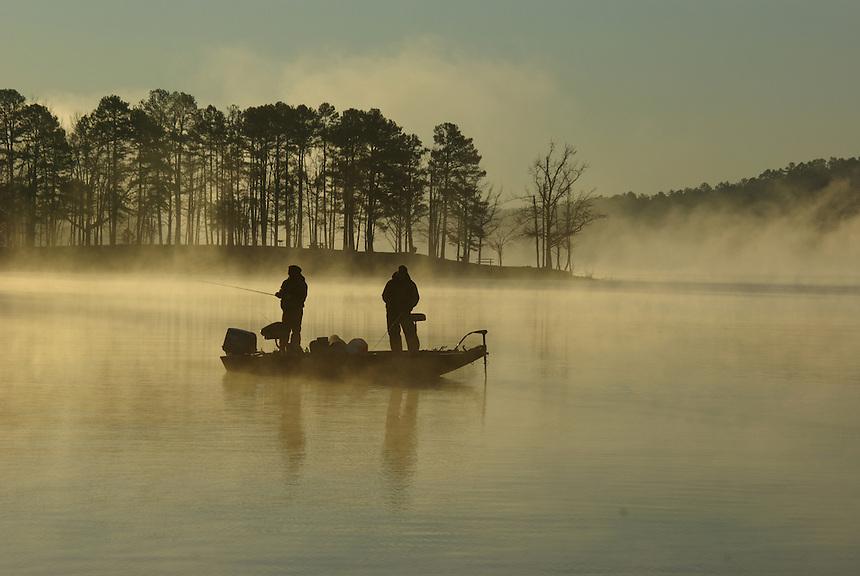 Bass anglers casting at dawn on Lake Greeson near Kirby, Arkansas