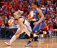 INDIANAPOLIS, IN - OCTOBER 21: Erin Phillips #13 of the Indiana Fever dribbles past Maya Moore #23 of the Minnesota Lynx during Game Four of the 2012 WNBA Finals on October 21, 2012 at Bankers Life Fieldhouse in Indianapolis, Indiana. NOTE TO USER: User expressly acknowledges and agrees that, by downloading and or using this Photograph, user is consenting to the terms and conditions of the Getty Images License Agreement. (Photo by Michael Hickey/Getty Images) *** Local Caption *** Erin Phillips; Maya Moore