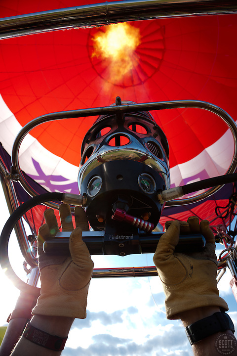 """Take Off 2"" - This photograph of a hot air balloon firing up and taking off was photographed at the 2011 Great Reno Balloon Race. Photographed from inside the hot air balloon basket."