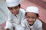 Two Cham muslim boys in their best clothes at the steps of the local village mosque, just after the afternoon prayer (Kompong Cham, Cambodia, 2012).
