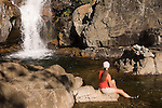 Female hiker relaxing by a swimming hole on Canyon Creek, Tahoe National Forest California