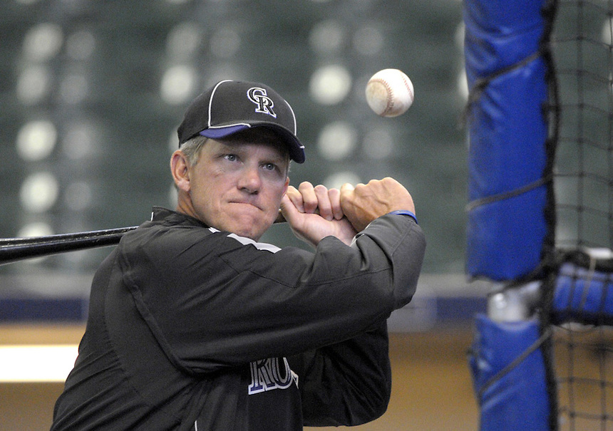Colorado Rockies manager Jim Tracy hits the ball during fielding practice at Miller Park in Milwaukee on April 4, 2010. The Rockies play in the Brewers home opener on Monday, April 5. Ernie Mastroianni photo for the Denver Post.