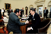 """United States President Ronald Reagan wins an arm wrestling bout with Dan Laurie, editor of """"Muscle Training Illustrated"""".  The match took place in the Oval Office, Thursday afternoon, February 16, 1984..Mandatory Credit: Pete Souza - White House via CNP"""