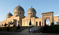 """A low angle view of Sheikhantaur Mausoleum, Tashkent, Uzbekistan, early 15th century and restored in the 19th century, seen in the late afternoon summer light on July 3, 2010. Tashkent, 2000 year old capital city of Uzbekistan, a Silk Road city whose name means """"Stone Fortress"""", is now very modern due to a disastrous earthquake in 1966, after which it was greatly rebuilt. However, some of the old buildings still stand in the glittering modern city."""