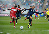 New England defender Darrius Barnes (25) prepares to knock the ball away from Chicago forward Dominic Oduro (8).  The Chicago Fire defeated the New England Revolution 3-2 at Toyota Park in Bridgeview, IL on Sept. 25, 2011.