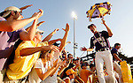 June 6, 2009; Baton Rouge, LA, USA; LSU Tigers pitcher Ryan Byrd (10) celebrates with fans in right field following the Tigers 5-3 victory against the Rice Owls during game two of the Super Regional at Alex Box Stadium in Baton Rouge. Mandatory Credit: Crystal LoGiudice-US PRESSWIRE