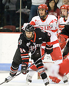 Drew Daniels (Northeastern - 24), Sahir Gill (BU - 28) - The visiting Northeastern University Huskies defeated the Boston University Terriers 5-4 on Sunday, March 13, 2011, to win their Hockey East Quarterfinal matchup 2 games to 1 at Agganis Arena in Boston, Massachusetts.