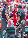 1 June 2014: Washington Nationals Manager Matt Williams discusses a reviewable play with the umpires during a game against the Texas Rangers at Nationals Park in Washington, DC. The Rangers shut out the Nationals 2-0 to salvage the third the third game of their 3-game inter-league series. Mandatory Credit: Ed Wolfstein Photo *** RAW (NEF) Image File Available ***
