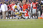 LSU wide receiver Odell Beckham Jr. (3) is tackled by Ole Miss wide receiver Cody Core (88) at Tiger Stadium in Baton Rouge, La. on Saturday, November 17, 2012. LSU won 41-35.....