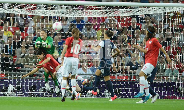 London, England - Thursday, August 9, 2012: The USA defeated Japan 2-1 to win the London 2012 Olympic gold medal at Wembley Stadium. Hope Solo makes a save over Japan's Saki Kumagi..