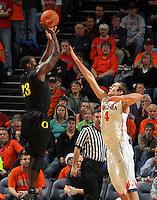 Dec. 17, 2010; Charlottesville, VA, USA; Oregon Ducks forward Jeremy Jacob (23) shoots the ball over Virginia Cavaliers forward Will Regan (4) during the game at the John Paul Jones Arena. Virginia won 63-48. Mandatory Credit: Andrew Shurtleff