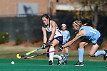 15 November 2014: Liberty's Bethany Barr (NIR) (left) and North Carolina's Julia Young (right). The University of North Carolina Tar Heels hosted the Liberty University Flames at Francis E. Henry Stadium in Chapel Hill, North Carolina in a 2014 NCAA Division I Field Hockey Tournament First Round game. UNC won the game 2-1.