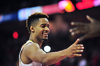 Melo Trimble high fives a teammate after the Terrapins take the lead. Maryland defeated Georgetown 75-71 during a game at Xfinity Center in College Park, MD on Wednesday, November 17, 2015.  Alan P. Santos/DC Sports Box